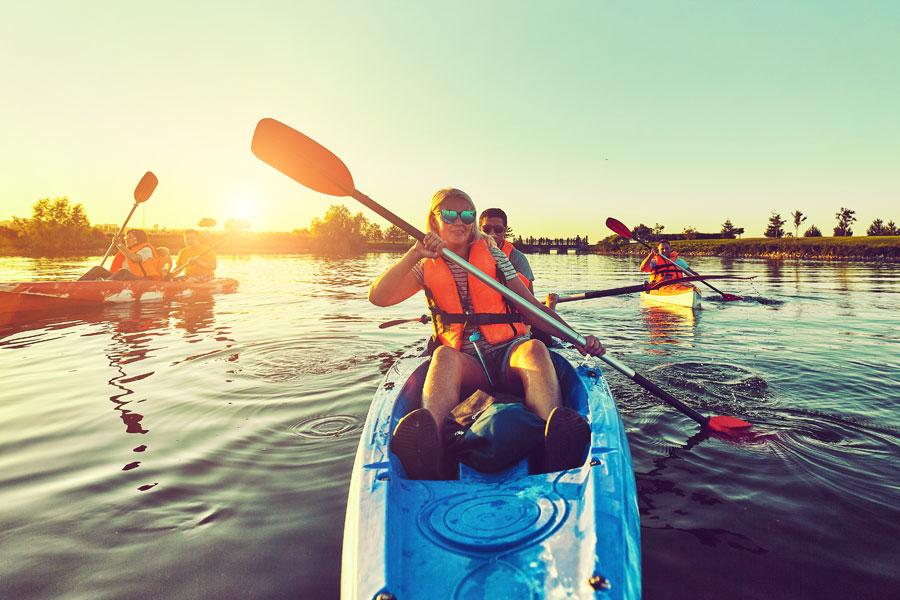 adults kayaking